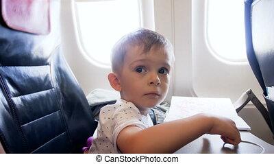 4k video of little toddler boy sitting on passenger seat in ...