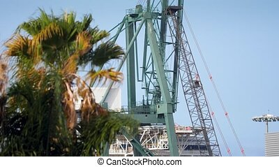 4k video of of heavy industrial laoding crane in sea port on...