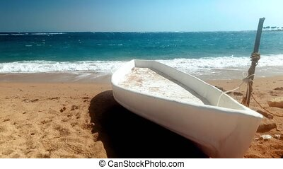 4k video of old white wooden canoe on the abandoned sandy...