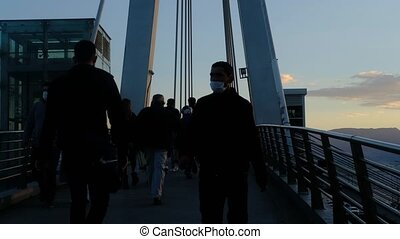 people walking on overpass