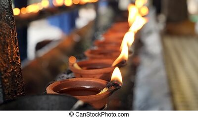 4k video of sacred fire in burning oil lanterns at hindu or ...
