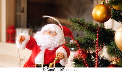 4k video of Santa Claus figure standing under CHristmas tree decorated with colorful lights at living room