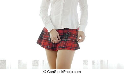 4k video of sexy slim student girl wearing red checkered...