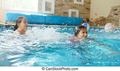4k video of two teenage girls splashing water in swimming pool