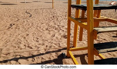 4k video of volleyball field on sea beach with golden sand...