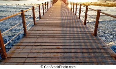 4k video of walking on the endless wooden pier in the ocean....