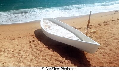 4k video of white wooden boat on the sandy sea beach at...