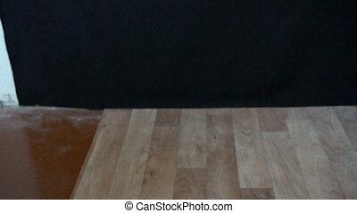 4k video rubber balls-jumpers jump on linoleum.slow motion