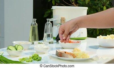 4k video. Salmon sauce with vapor vegetables served on a vintage plate