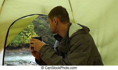 4k. view from a tourist tent on a mountain river. the guy...