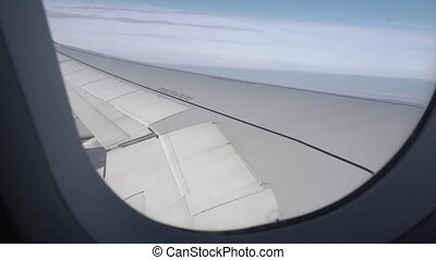 4k View from the porthole on the wing of the plane. Flight...