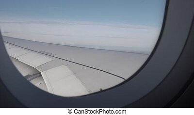 4k View from the window on the wing of the plane.