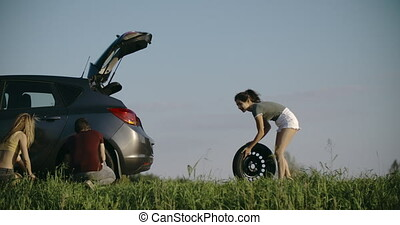 4k Woman stands at broken car after road trouble problem...