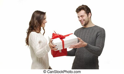 4k Young couple showing and exchanging presents in Chrismas...