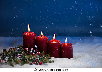 4th Advent candle in snow and snowfall