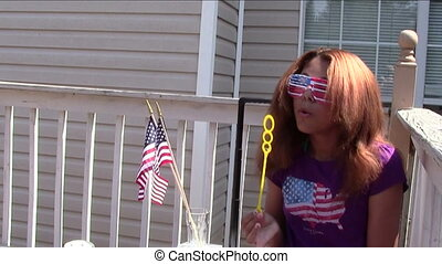 4th of July Bubbles - Teenaged girl blowing bubbles