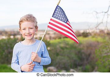 4th of july celebration - positive smiling boy holding...