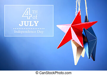 4th of July decorations on blue background