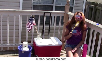 4th of July Fun - Teen girl blowing bubbles