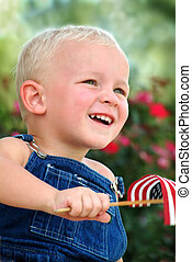 4th of July - Young boy waving flag
