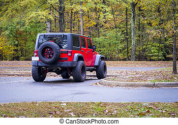 4WD all-terrain vehicle parked in woodland - Red 4WD...