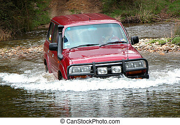 4WD Crossing River at Geehi in the Australian Alps