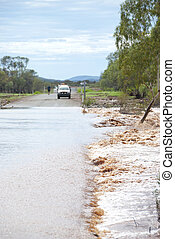 4WD waiting to cross flooded road
