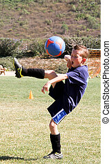 4.Youth playing soccer doing high