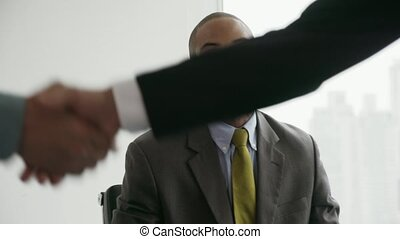 5 Business People Shaking Hands At Office Meeting With Advisor