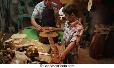5-Lute Maker Grandpa Teaching Boy Grandson Tuning Guitar -...