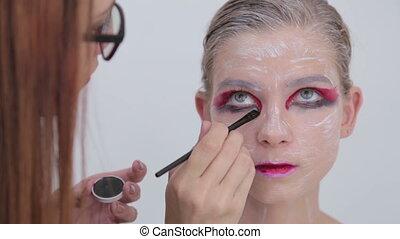 5 shots. Professional make-up creating face makeup art