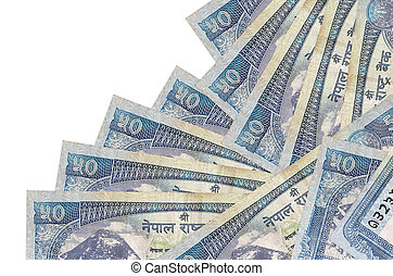 50 Nepalese rupees bills lies in different order isolated on white. Local banking or money making concept. Business background banner
