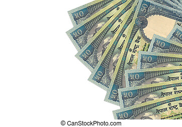 50 Nepalese rupees bills lies isolated on white background with copy space. Rich life conceptual background. Big amount of national currency wealth