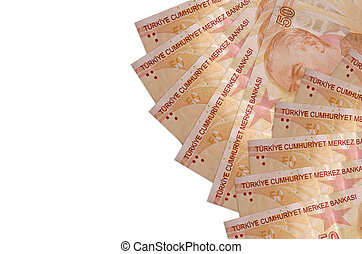 50 Turkish liras bills lies isolated on white background with copy space. Rich life conceptual background. Big amount of national currency wealth