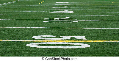 50-Yard Line - Looking down the football field from the 50-...