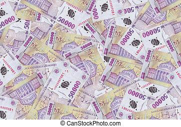 50000 Romanian leu bills lies in big pile. Rich life conceptual background. Big amount of money