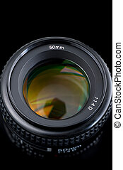 50mm lens view from the top on black background, closeup.