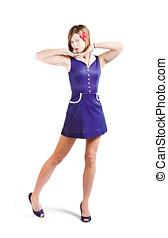 50s pin-up girl in retro purple polka dot dress