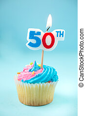 50th candle on a cupcake on a blue background