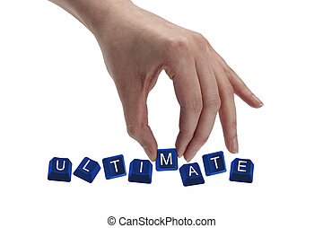 Concept shot of hand holding keyboard keys and spelling the word ultimate.