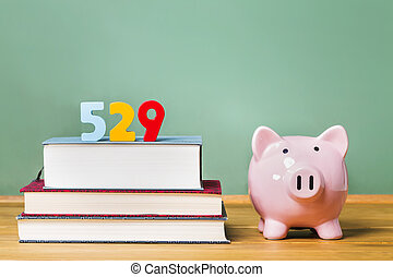 529 college savings plan theme with textbooks and piggy bank...