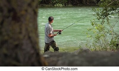 5of8 Man with fishing rod on river - Man and leisure...