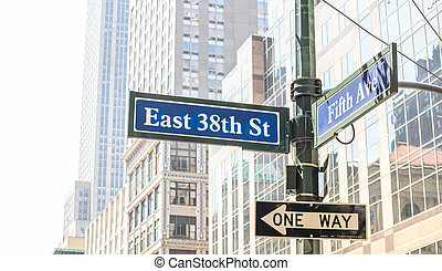 5th ave and E38 corner. Blue color street signs, Manhattan New York downtown