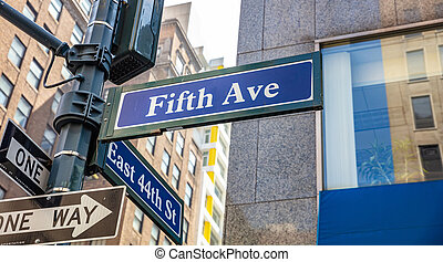5th ave and E44 corner. Blue color street signs, Manhattan New York downtown