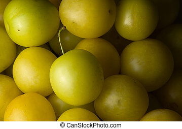 6 - Full frame food background of yellow mirabelle plums, home made.