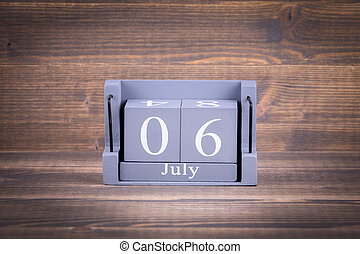 6 July. Wooden, square calendar