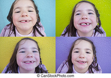 6 years old girl showing her first baby incisor fallen out