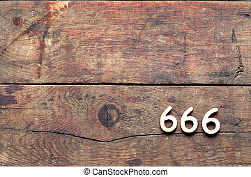 666 Number On Wood - 666 sign on old wooden background with ...