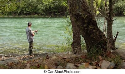 6of8 Man with fishing rod on river