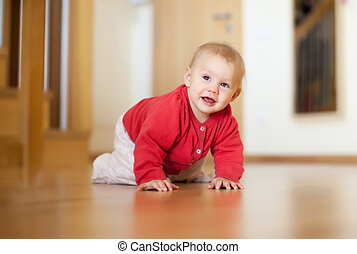baby girl smiling on floor